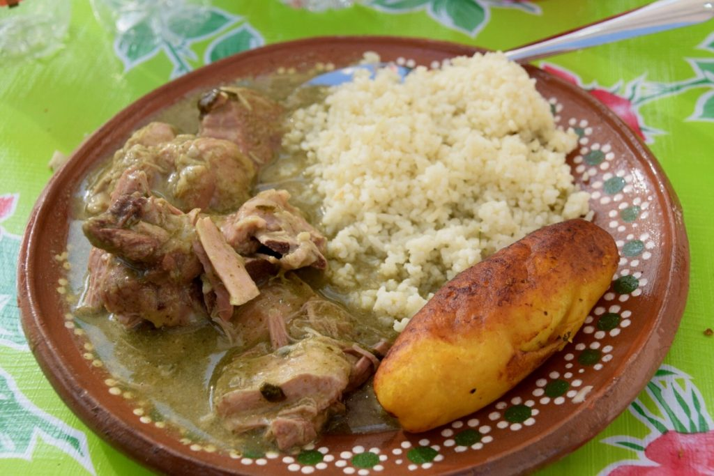 Pork in mole verde with fried plantain from state of Tabasco, FMGM, CENART, Mexico City, Mexico